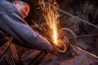the blacksmith polishing metal products
