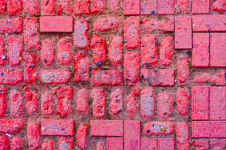 Worn footpath walk textured in red brick blocks floor above view. Red rectangle shape clay tile floor pattern. Clay brick pavement. Worn footpath textured