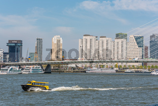 Water taxi speeding on the river in Rotterdam, Netherlands