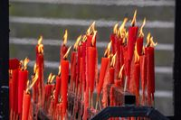 Red candles burning in a taoist temple