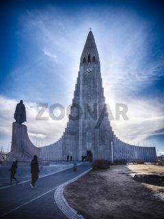 People near amazing Lutheran church in Iceland