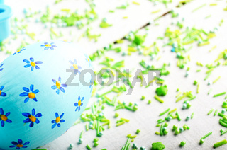 Painted decorated easter eggs with sprinkles on white table