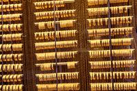 Shop display of dozens of golden bracelets