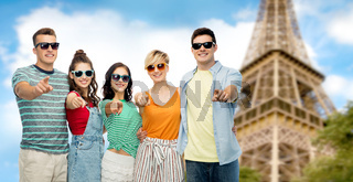 friends pointing at you over eiffel tower