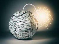 Searching new job concept. Bomb from newspapers  with job vacations  and  wick and sparks.