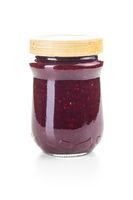 Raspberry jam in jar.