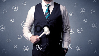 Handsome man standing with tool on his hand