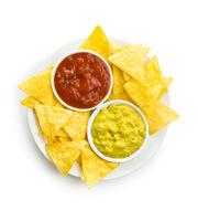 Corn nacho chips with avocado and tomato dip.