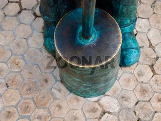 detail of bronze statue, hammer to build paving stone floor Lisbon, Portugal