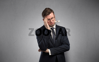 Businessman with thermometer and copy space