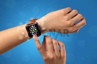 Female hand with smartwatch and app icons