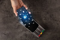 Hand paying with cellphone on POS
