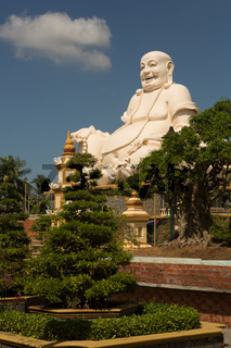 Big laughing sitting outdoor Buddha in Vinh Trang Pagoda in South Vietnam