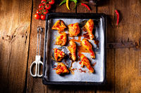 Rustic backed chicken wings,legs on baking tray