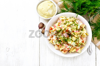Salad of surimi and eggs with mayonnaise on board top