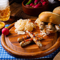 rustic Thuringian bratwurst with sauerkraut and roll