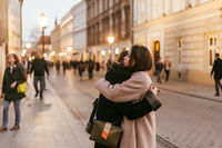 Close-up photo of two emotional woman friends hugging each other