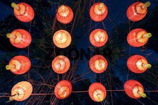 Group of red chinese lanterns illuminated at night