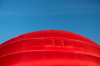 Detail of a starting red hot air balloon