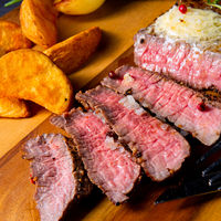 rustic medium butter beef steak with herbs and potato wedges