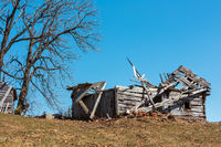 Ruined shed on early spring plateau