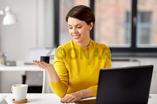 businesswoman using smart speaker at office
