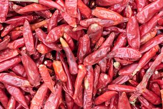Red dried chili pepper heap close-up
