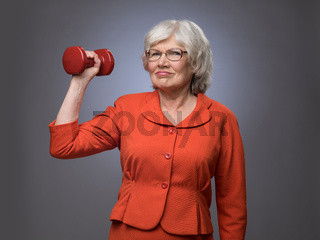 Senior lady with dumbbell