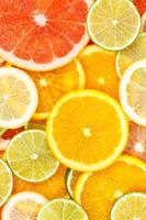 Citrus fruits collection food background oranges lemons limes portrait format grapefruit fresh fruit