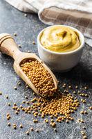 Yellow mustard and mustard seeds.