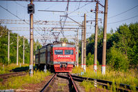 Russian train in the summer. The train rides in the summer at sunset. The train pulls up. . Russia, Oranienbaum July 31, 2018