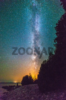 Milky way and starry sky along the lakeshore of Georgian Bay at