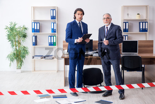 Two experts criminologists working in the office