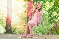 Cute little girl having fun on a swing
