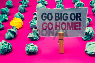 Writing note showing  Go Big Or Go Home Motivational Call. Business photo showcasing Mindset Ambitious Impulse Persistence Emerald paper balls yellow lump rosy floor paperclip retain grey page.