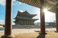 Gyeongbokgung Palace with sun flare in Seoul city, South Korea