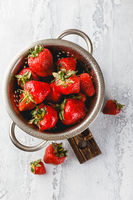Fresh strawberries in a while colander