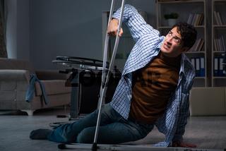 Man fell off wheelchair sitting on the floor
