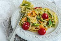 Italian pasta with vegetables, parmesan and lemon zest.