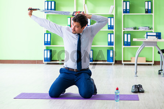 Employee doing exercises during break at work