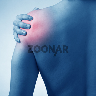 Man suffering from acute pain in shoulder