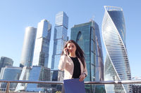 Businesswoman at skyscraper background