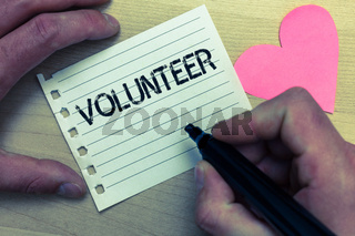 Text sign showing Volunteer. Conceptual photo Volunteering individual for greater social cause serving others Wood nice love colour hart marker pen art work memories black shadow.