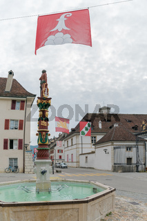 view of the historic 'Fountain du Sauvage' or Fountain of the Savage in the Swiss city of Delemont