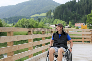 Disabled young man on a wheelchair