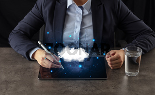 Business woman working on tablet with cloud technology concept