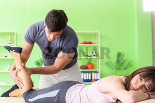 Young doctor chiropractor massaging patient