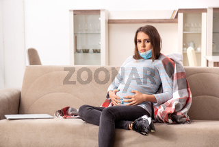 Sick pregnant woman suffering at home