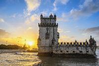 Lisbon Portugal sunrise city skyline at Belem Tower and Tagus River