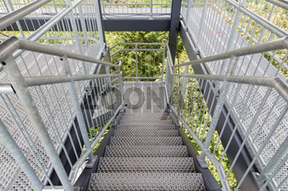 Steel staircase of an observation tower in the forest